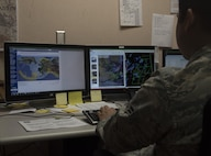 U.S. Air Force Airman 1st Class Anthony Ohara, a 35th Operations Support Squadron weather forecaster, examines a weather cycle during RED FLAG-Alaska 17-2, at Eielson Air Force Base, Alaska, June 16, 2017. Weather cycles are used to forecast several days out and determine how different factors of the climate will affect each flight mission. (U.S. Air Force photo by Airman 1st Class Sadie Colbert)