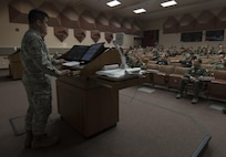 U.S. Air Force Airman 1st Class Anthony Ohara, a 35th Operations Support Squadron weather forecaster, gives a mass briefing on the current climate happenings during RED FLAG-Alaska 17-2 at Eielson Air Force Base, Alaska, June 16, 2017. During the exercise, Ohara and his coworker, Senior Airman Joseph Goebel, a 35th OSS weather forecaster, briefed participants of RF-A 17-2 from both Eielson AFB and Joint Base Elmendorf-Richardson, Alaska, using video calls. (U.S. Air Force photo by Airman 1st Class Sadie Colbert)
