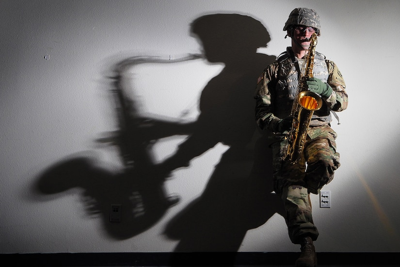 """Army Sgt. Charles Moncayo, a native of Newport News, Va., assigned to the 9th Army Band, 17th Combat Sustainment Support Battalion, U.S. Army Alaska, plays his saxophone at the 9th Army Band headquarters on Joint Base Elmendorf-Richardson, Alaska, May 3, 2017.  Moncayo has a musical family history including famous American songwriter James Cavanaugh best known for penning 20th century favorites such as """"Christmas in Killarney"""", """"You're Nobody till Somebody Loves You"""", and """"Mississippi Mud."""""""