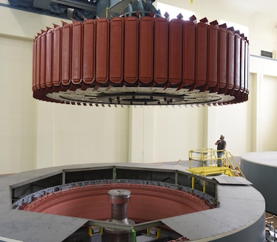 Kye Moss of Voith Hydro guides a 249-ton rotor during its installation into hydropower unit two at Center Hill Dam in Lancaster, Tenn., June 19, 2017. The U.S. Army Corps of Engineers Nashville District is rehabilitating the unit and expects to bring it online in late July after the completion of its assembly and load testing.