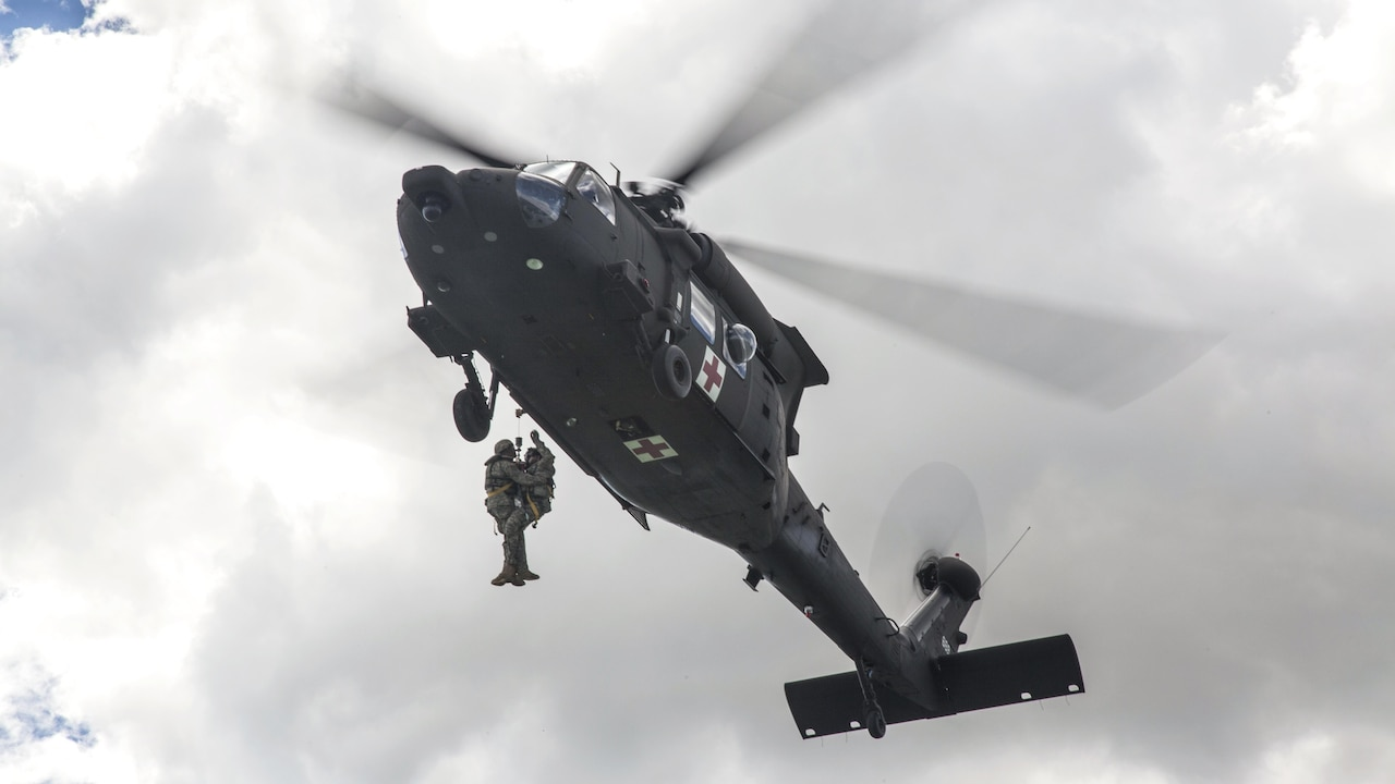 Soldiers hoist a simulated wounded soldier into an HH60-M Medevac Blackhawk during the Golden Coyote training exercise in Belle Fourche Reservoir, S.D., June 19, 2017. The scenario-driven exercise enables commanders to focus on warrior tasks and battle drills. The soldiers are assigned to Company C, 1st Battalion, 189th Aviation Regiment, South Dakota Army National Guard. Army photo by Spc. Mitchell Murphy