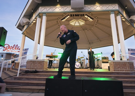 Senior Master Sgt. Ryan Carson, Max Impact vocalist and superintendent, sings during a concert June 17, 2017, at the Rehoboth Beach Bandstand, in Rehoboth Beach, Del. Max Impact is stationed out of Joint Base Anacostia-Bolling in Washington, D.C. (U.S. Air Force photo by Senior Airman Zachary Cacicia)