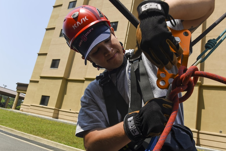 U.S. Air Force Senior Airman Donavin Apiag, 8th Civil Engineer Squadron fire emergency services driver/operator unhooks a Stokes basket after lowering it during training at Kunsan Air Base, Republic of Korea, June 8, 2017. Apiag participated in the Department of Defense Technical Rescue Course which taught students from the Pacific Air Forces region high and low angle, confined space, and technical rope rescues. (U.S. Air Force photo by Senior Airman Michael Hunsaker/Released)