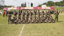U.S. Marines with Communications Company, Headquarters Battalion, 3d Marine Division, pose for a group photo after the drill competition held at the Courtney Bowl on Camp Courtney, Okinawa, Japan, March 31, 2017. Headquarters Company, Truck Company, and Communications Company engaged in a competition against each other for a drill trophy and to aid in preparation for an upcoming commanding general inspection.  (U.S. Marine Corps photo by MCIPAC Combat Camera Lance Cpl.  Jesus McCloud)