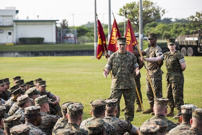 U.S. Marine Corps Col. George G. Malkasian, Commanding Officer of Headquarters Battalion, 3d Marine Division, speaks to Marines about Marine Corps' customs and courtesies and the importance of close order drill at the drill competition at the Courtney Bowl on Camp Courtney, Okinawa, Japan, March 31, 2017. Headquarters Company, Truck Company, and Communications Company engaged in a competition against each other for a drill trophy and to aid in preparation for an upcoming commanding general inspection.  (U.S. Marine Corps photo by MCIPAC Combat Camera Lance Cpl.  Jesus McCloud)