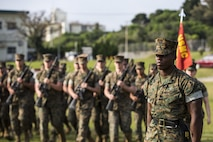 "U.S. Marine Corps Sgt. Andrew Smith, with Headquarters Company, Headquarters Battalion, 3d Marine Division, commands his Marines to ""fall in"" during a drill competition at the Courtney Bowl, on Camp Courtney, Okinawa, Japan, March 31, 2017. Headquarters Company, Truck Company, and Communications Company engaged in a competition against each other for a drill trophy and to aid in preparation for an upcoming commanding general inspection.  (U.S. Marine Corps photo by MCIPAC Combat Camera Lance Cpl.  Jesus McCloud)"