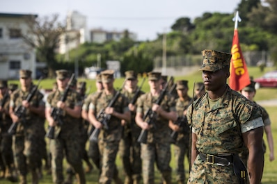"""U.S. Marine Corps Sgt. Andrew Smith, with Headquarters Company, Headquarters Battalion, 3d Marine Division, commands his Marines to """"fall in"""" during a drill competition at the Courtney Bowl, on Camp Courtney, Okinawa, Japan, March 31, 2017. Headquarters Company, Truck Company, and Communications Company engaged in a competition against each other for a drill trophy and to aid in preparation for an upcoming commanding general inspection.  (U.S. Marine Corps photo by MCIPAC Combat Camera Lance Cpl.  Jesus McCloud)"""