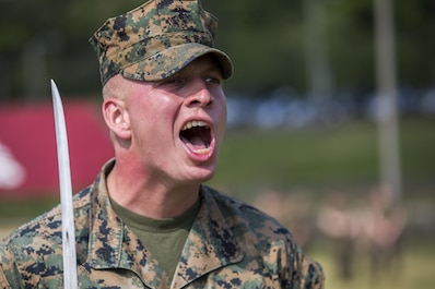 U.S. Marine Corps Sgt. Tyler Cooper, U.S. Marine Corps Sgt. Tyler Cooper, with Truck Company, Headquarters Battalion, 3d Marine Division, marches his platoon during a drill competition at the Courtney Bowl on Camp Courtney, Okinawa, Japan, March 31, 2017. Headquarters Company, Truck Company, and Communications Company engaged in a competition against each other for a drill trophy and to aid in preparation for an upcoming commanding general inspection.  (U.S. Marine Corps photo by MCIPAC Combat Camera Lance Cpl.  Jesus McCloud)