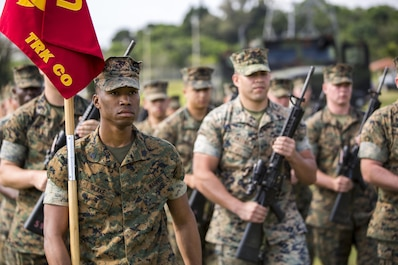 U.S. Marines with Headquarters Battalion, 3d Marine Division conduct a drill competition at the Courtney Bowl on Camp Courtney, Okinawa, Japan, March 31, 2017. Headquarters Company, Truck Company, and Communications Company engaged in a competition against each other for a drill trophy and to aid in preparation for an upcoming commanding general inspection.  (U.S. Marine Corps photo by MCIPAC Combat Camera Lance Cpl.  Jesus McCloud)