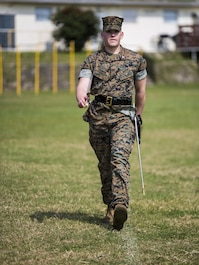 U.S. Marine Corps 1stLt Andrew Turnbow, with Truck Company, Headquarters Battalion, 3d Marine Division, conducts sword manual during a drill competition at the Courtney Bowl on Camp Courtney, Okinawa, Japan, March 31, 2017. Headquarters Company, Truck Company, and Communications Company engaged in a competition against each other for a drill trophy and to aid in preparation for an upcoming commanding general inspection.  (U.S. Marine Corps photo by MCIPAC Combat Camera Lance Cpl.  Jesus McCloud)