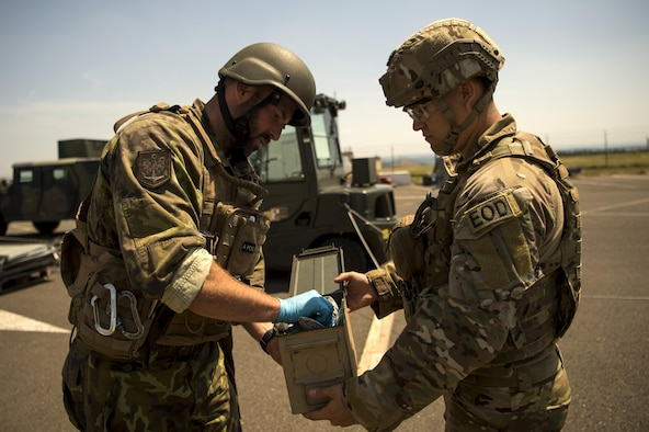 U.S. Air Force Staff Sgt. Arlen Calhoun, 786th Civil Engineer Squadron explosive ordnance disposal team member, holds an evidence tool box open for Army of the Czech Republic Sgt. 1st Class Milan Pagurko, EOD member, during the second annual multilateral Improvised Explosive Device Rodeo at Spangdahlem Air Base, Germany, June 15, 2017. EOD members from Germany, Czech Republic, The Netherlands, Sweden, Ramstein Air Base, Spangdahlem Air Base, and Grissom Air Reserve Base, Indiana took part in the five day event to train on IED's while learning tactics, techniques and procedures from each other. (U.S. Air Force photo by Senior Airman Preston Cherry)