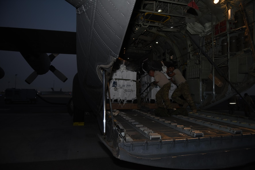 Loadmasters with the 737th Expeditionary Airlift Squadron work together to secure a container delivery system in the cargo bay of a C-130 Hercules in preparation for an air drop at an undisclosed location in Southwest Asia, over the weekend. Providing the fuel that keeps the fight going, the 386th Air Expeditionary Wing has delivered more than 80 tons of food, water and other supplies to various supported forces throughout the U.S. Air Forces Central Command area of responsibility in support of Combined Joint Task Force - Operation Inherent Resolve ground troops. (U.S. Air Force photo/Tech. Sgt. Jonathan Hehnly)