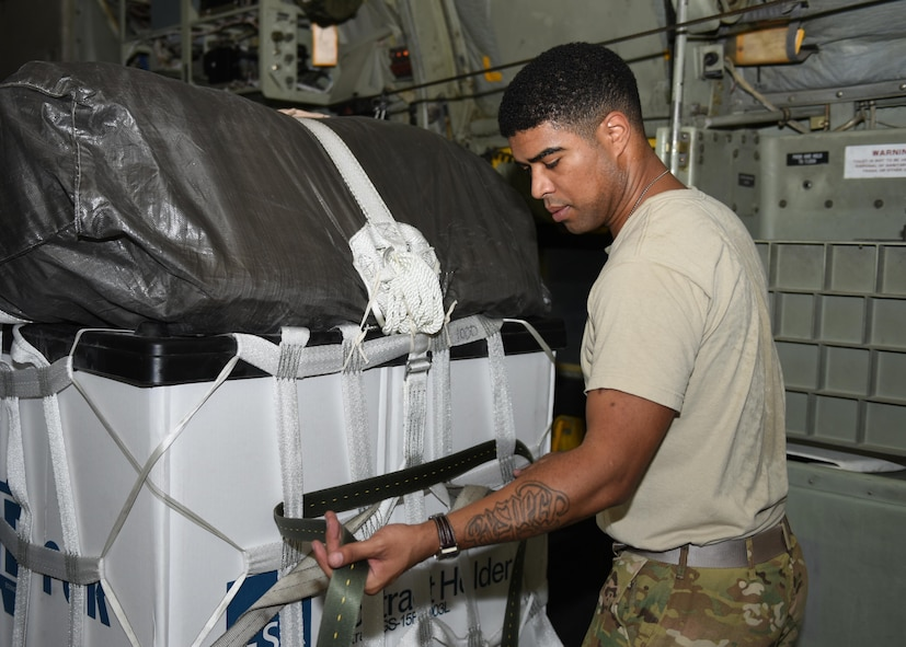 Tech. Sgt. Jimmy Sealey, a loadmaster with the 737th Expeditionary Airlift Squadron, straps down a container delivery system in the cargo bay of a C-130 Hercules in preparation for an air drop at an undisclosed location in Southwest Asia, over the weekend. Providing the fuel that keeps the fight going, the 386th Air Expeditionary Wing has delivered more than 80 tons of food, water and other supplies to various supported forces throughout the U.S. Air Forces Central Command area of responsibility in support of Combined Joint Task Force - Operation Inherent Resolve ground troops. (U.S. Air Force photo/Tech. Sgt. Jonathan Hehnly)