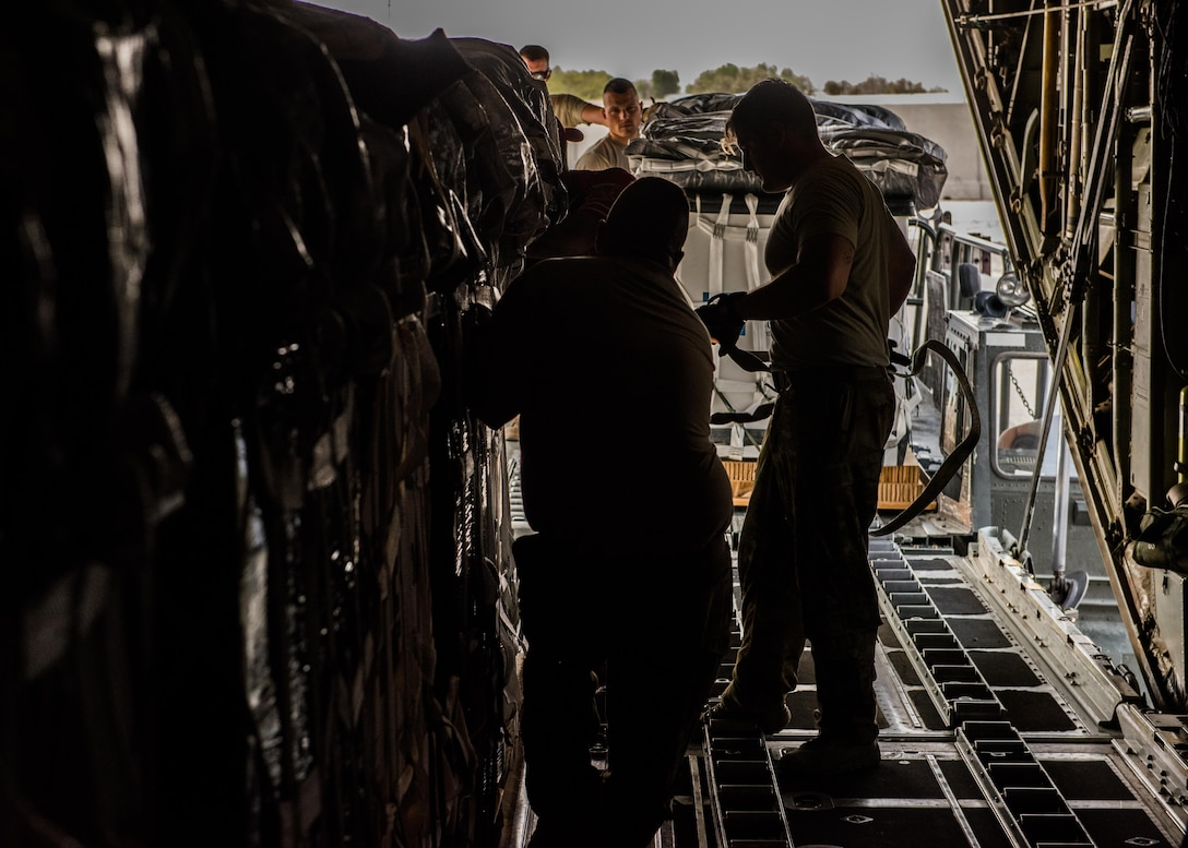Loadmasters with the 737th Expeditionary Airlift Squadron and air transportation specialists with the 386th Expeditionary Logistics Readiness Squadron work together to load container delivery systems into the cargo bay of a C-130 Hercules in preparation for an air drop at an undisclosed location in Southwest Asia, over the weekend. Providing the fuel that keeps the fight going, the 386th Air Expeditionary Wing has delivered more than 80 tons of food, water and other supplies to various supported forces throughout the U.S. Air Forces Central Command area of responsibility in support of Combined Joint Task Force - Operation Inherent Resolve ground troops. (U.S. Air Force photo/Tech. Sgt. Jonathan Hehnly)
