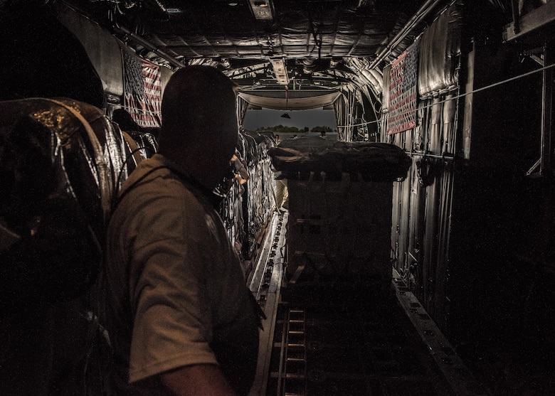 Chief Master Sgt. Ned Seaman, a loadmaster with the 737th Expeditionary Airlift Squadron, receives a container delivery system in the cargo bay of a C-130 Hercules in preparation for an air drop at an undisclosed location in Southwest Asia, over the weekend. Providing the fuel that keeps the fight going, the 386th Air Expeditionary Wing has delivered more than 80 tons of food, water and other supplies to various supported forces throughout the U.S. Air Forces Central Command area of responsibility in support of Combined Joint Task Force - Operation Inherent Resolve ground troops. (U.S. Air Force photo/Tech. Sgt. Jonathan Hehnly)