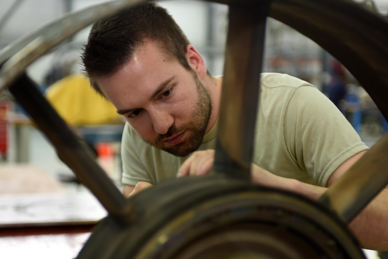 An Airman assigned to the 48th Component Maintenance Squadron inspects a turbine exhaust case at Royal Air Force Lakenheath, England, June 13. Part of the 48th CMS's responsibilities include the routine maintenance of F-15 engines. (U.S. Air Force photo/Airman 1st Class Eli Chevalier)
