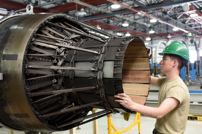 An Airman assigned to the 48th Component Maintenance Squadron maneuvers an F-15 engine at Royal Air Force Lakenheath, England, June 13. The 48th CMS is responsible for the installation's propulsions shop, where maintenance is performed on F-15 engines. (U.S. Air Force photo/Airman 1st Class Eli Chevalier)