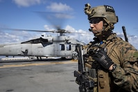 Staff Sgt. Abel Contreras, communications chief with the 31st Marine Expeditionary Unit's Force Reconnaissance Platoon, waits to board an MH-60S Sea Hawk helicopter aboard the USS Bonhomme Richard before launching for vessel Visit, Board, Search and Seizure training, June 15, 2017.  During VBSS, Marines with FRP board vessels via rotary-wing aircraft or surface boats in response to a terrorist threat, to interdict pirates and smugglers or to disrupt criminal activity.  The 31st MEU partners with the Navy's Amphibious Squadron 11 to form the amphibious component of the Bonhomme Richard Expeditionary Strike Group. The 31st MEU and PHIBRON 11 combine to provide a cohesive blue-green team capable of accomplishing a variety of missions across the Indo-Asia-Pacific region.
