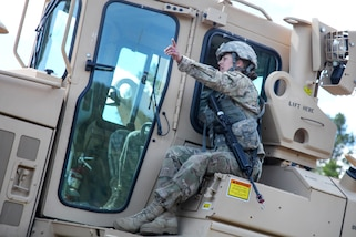 South Dakota Army National Guard Sgt. Kymberlee Hassebroek, foreground, instructs Spc. Justin Barden where to level dirt using a D7 Dozer in support of Golden Coyote, Lead, S.D., June 14, 2017. Hassebroek and Barden are assigned to the 842nd Engineer Company. Army photo by Spc. Jeffery Harris