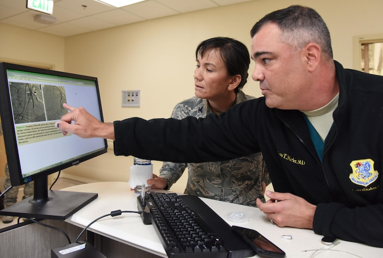 Maj. Adam Marler, 81st Medical Operations Squadron cardiologist, briefs Col. Debra Lovette, 81st Training Wing commander, on the cardiology department capabilities during an 81st Medical Group orientation tour in the Keesler Medical Center June 16, 2017, on Keesler Air Force Base, Miss. The purpose of the tour was to familiarize Lovette with the group's mission, operations and personnel. (U.S. Air Force photo by Kemberly Groue)