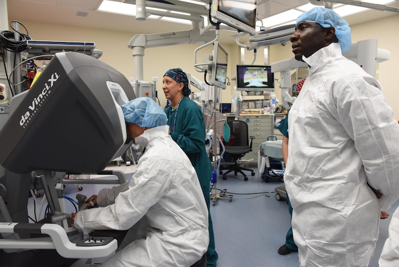 Second Lt. Nina Hoskins, 81st Surgical Operations Squadron operating room nurse, assists Col. Debra Lovette, 81st Training Wing commander, with operating a robotics surgical system inside the robotics surgery clinic during an 81st Medical Group orientation tour in the Keesler Medical Center June 16, 2017, on Keesler Air Force Base, Miss. The purpose of the tour was to familiarize Lovette with the group's mission, operations and personnel. (U.S. Air Force photo by Kemberly Groue)