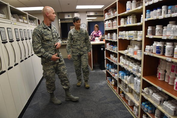 Capt. Ian Gaspar, 81st Diagnostic and Therapeutics Squadron pharmacy officer in charge, briefs Col. Debra Lovette, 81st Training Wing commander, on pharmacy capabilities and procedures during an 81st Medical Group orientation tour in the Keesler Medical Center June 16, 2017, on Keesler Air Force Base, Miss. The purpose of the tour was to familiarize Lovette with the group's mission, operations and personnel. (U.S. Air Force photo by Kemberly Groue)