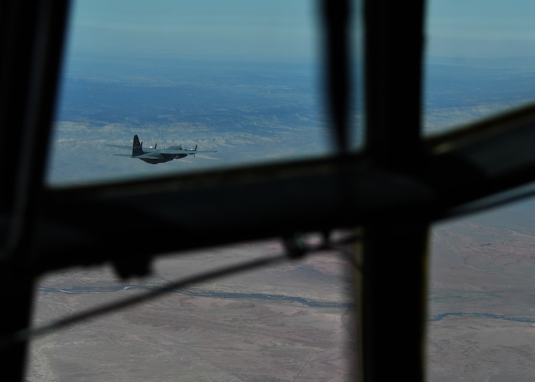 A C-130 Hercules aircraft flies across the Nevada desert on its way to participate in the Joint Forcible Entry exercise outside of Nellis Air Force Base, Nevada, June 10, 2017. During the JFE Vul Exercise, more than 100 aircraft and their crews worked together in a simulated contested degraded environment to train as a large formation in an enemy environment. (U.S. Air Force photo by Staff Sgt. Miles Wilson)