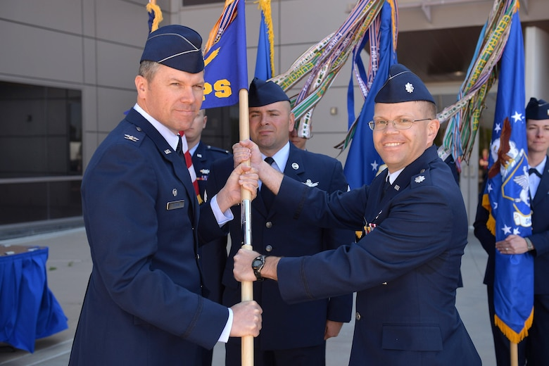 Col. Toby Doran, 50th Operations Group commander, presents the guidon to Lt. Col. Armon Lansing, 4th Space Operations Squadron incoming commander, during the 4 SOPS change of command ceremony at Schriever Air Force Base, Colorado, Tuesday, June 13, 2017. Lansing assumed command from Lt. Col. Sherman Johns who is transitioning to the National Space Defense Center. (U.S. Air Force photo/Dennis Rogers)