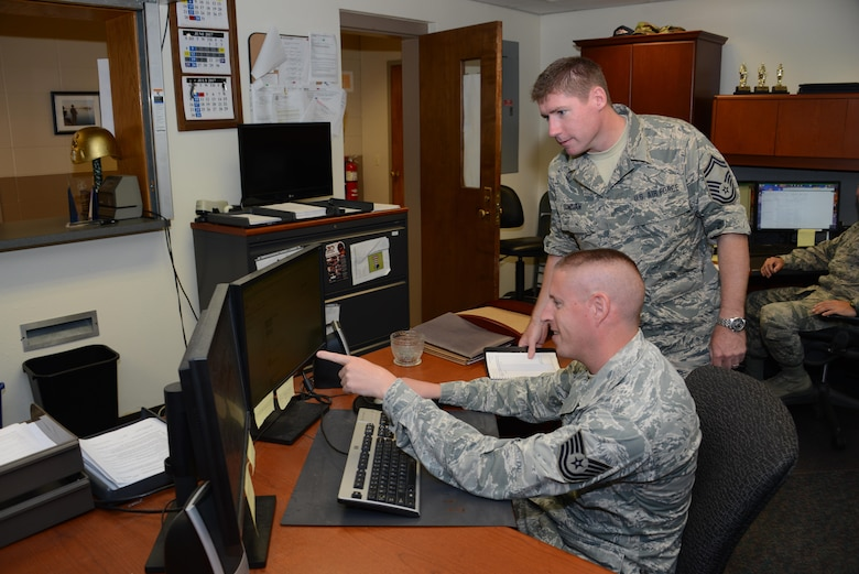Senior Master Sgt. Joe Donovan 185th Air Refueling Wing Financial Management Superintendent, talks with Technical Sgt. Mike Winter 185th ARW Travel Pay Technician while at the Iowa Air National Guard's 185th ARW Financial Management office in Sioux City, Iowa on June 21, 2017.