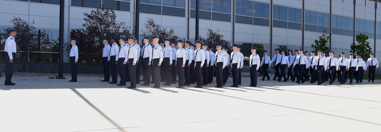 3rd Space Operations Squadron and 4th Space Operations Squadron Airmen merge in formations during the 3 SOPS inactivation and 4 SOPS change of command ceremony at Schriever Air Force Base, Colorado, Tuesday, June 13, 2017. At the start of the ceremony, the two squadrons stood separately, then merged into a single formation to symbolize the unification of two missions committed to drive the combined squadron to greater heights. (U.S. Air Force photo/Senior Airman Arielle Vasquez)