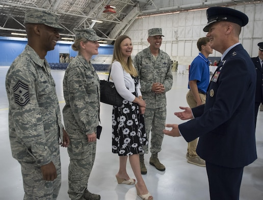 Maj. Gen. James Jacobson (right) talks with the 11th Wing Commander Col. E. John Teichert and members of the 11th Wing Command staff after assuming  command of the Air Force District of Washington during a ceremony on Joint Base Andrews, Md. June 20, 2017. Air Force Vice Chief of Staff Gen. Stephen Wilson (left) presided over the ceremony where Maj. Gen. Darryl Burke relinquished command to Jacobson. (U.S. Air Force photo/Jim Varhegyi)(released)