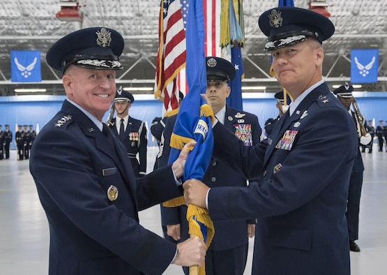 Maj. Gen. James Jacobson (right) assumes  command of the Air Force District of Washington during a ceremony on Joint Base Andrews, Md. June 20, 2017. Air Force Vice Chief of Staff Gen. Stephen Wilson (left) presided over the ceremony where Maj. Gen. Darryl Burke relinquished command to Jacobson. (U.S. Air Force photo/Jim Varhegyi)(released)