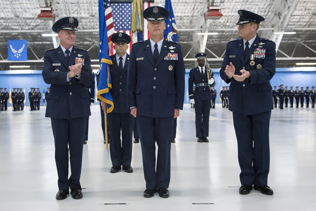 Maj. Gen. James Jacobson (center) assumes  command of the Air Force District of Washington during a ceremony on Joint Base Andrews, Md. June 20, 2017. Air Force Vice Chief of Staff Gen. Stephen Wilson (left) presided over the ceremony where Maj. Gen. Darryl Burke relinquished command to Jacobson. (U.S. Air Force photo/Jim Varhegyi)(released)