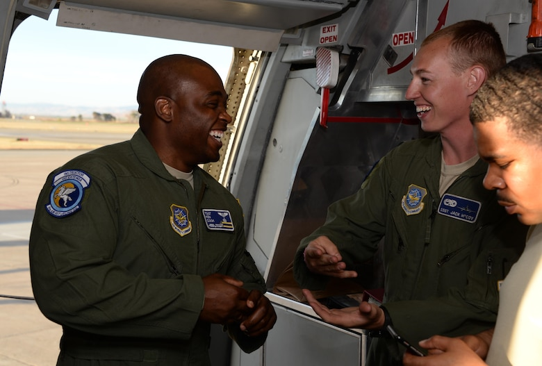 Tech. Sgt. Kenneth Cook (Left), 6th Air Refueling Squadron, shares a laugh with Staff Sgt. Jack McCoy, 660th Aircraft Maintenance Squadron, inside a KC-10 Extender prior to loading operations at Travis Air Force Base, Calif., June 17, 2017. Cook oversaw the loading of more than 15,000 pounds of cargo prior to a flight to Joint Base Pearl Harbor-Hickam, Hawaii. (U.S. Air Force photo by Tech. Sgt. James Hodgman)