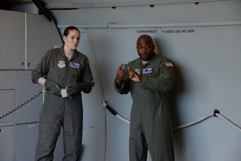 Airman 1st Class Neesen Bristow (Left), 6th Air Refueling Squadron, listens to Tech. Sgt. Kenneth Cook (Right), 6th ARS, provide instruction on KC-10 Extender loading operations at Travis Air Force Base, Calif., June 17, 2017. Cook oversaw the loading of more than 15,000 pounds of cargo prior to a flight to Joint Base Pearl Harbor-Hickam, Hawaii. (U.S. Air Force photo by Tech. Sgt. James Hodgman)