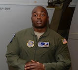 Tech. Sgt. Kenneth Cook, 6th Air Refueling Squadron, poses for a photo inside a KC-10 Extender at Travis Air Force Base, Calif., June 17, 2017, prior to the start of loading operations. Cook oversaw the loading of the more than 15,000 pounds of cargo prior to a flight to Joint Base Pearl Harbor-Hickam, Hawaii. (U.S. Air Force photo by Tech. Sgt. James Hodgman)