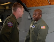 Staff Sgt. Jack McCoy (Left), 6th Air Refueling Squadron, chats with Tech. Sgt. Kenneth Cook (Right), 6th ARS, inside a KC-10 Extender prior to loading operations at Travis Air Force Base, Calif., June 17, 2017. Cook oversaw the loading of more than 15,000 pounds of cargo prior to a flight to Joint Base Pearl Harbor-Hickam, Hawaii. (U.S. Air Force photo/Tech. Sgt. James Hodgman)