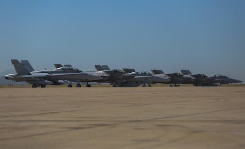 Three F-35B Lightning II and three F/A-18 Hornets line up before taking off during the Marine Division Tactics Course at Marine Corps Air Station Miramar, Calif., June 16. This course gives pilots air-to-air combat experience and the tools to train Marines in their squadrons on the latest tactics. (U.S. Marine Corps photo by Sgt. Kimberlyn Adams/Released)