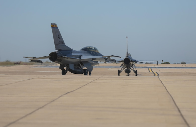 Two F-16 Fighting Falcons with the 21st Fighter Squadron out of Luke Air Force Base, Ariz., taxi to the runway during the Marine Division Tactics Course at Marine Corps Air Station Miramar, Calif., June 15. This course gives pilots air-to-air combat experience and the tools to train Marines in their squadrons on the latest tactics. (U.S. Marine Corps photo by Sgt. Kimberlyn Adams/Released)