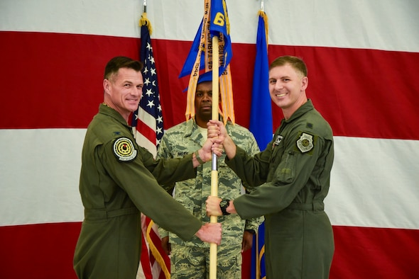 Lt. Col. Michael Blauser, 6th Weapons Squadron commander, assumes command of the squadron from Col. Michael Drowley, US Air Force Weapons School commandant, June 20, 2017, at Nellis Air Force Base, Nev. The 6th WPS was inactivated more than 70 years ago due to force-wide budget cuts. (U.S. Air Force photo by Airman 1st Class Andrew D. Sarver/Released)
