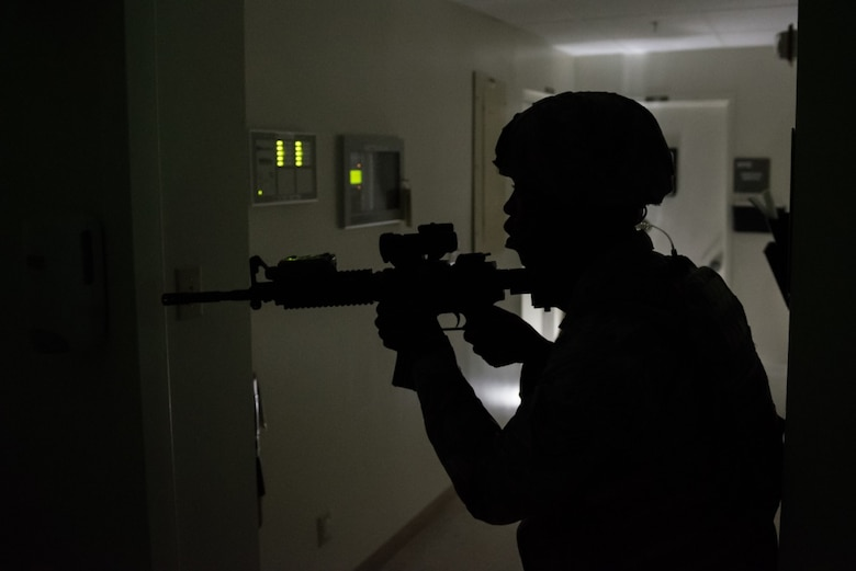 U.S. Air Force Staff Sgt. Gene McLaurin, 36th Security Forces Squadron, searches for additional threats after an active shooter was neutralized during an emergency management exercise May 11, 2017, at Andersen Air Force Base, Guam. When known active shooters are no longer a threat, SFS Airmen clear the building to ensure the area is safe. (U.S. Air Force photo by Airman 1st Class Jacob Skovo)