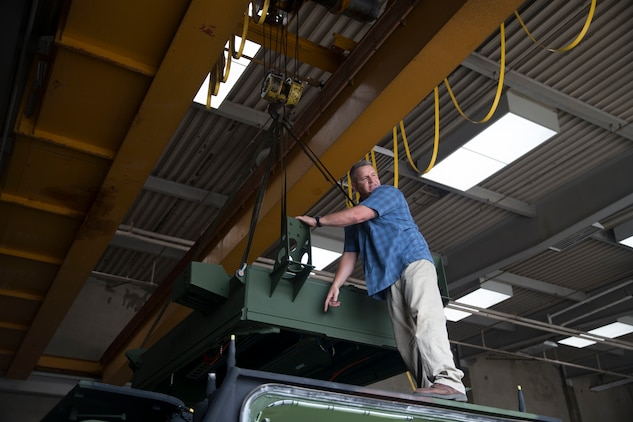 James Goodwin, instructor for the MK-154 Launcher Mine Clearance kit course, prepares a MK-154 LCM to be installed onto an assault amphibious vehicle on Camp Pendleton, Calif., June 19, 2017. The MK-154 LMC is being reintroduced to the fleet after safety issues halted its employment in 2013. The system is the only amphibious breaching capability within the Department of Defense, allowing the forces assault mined areas. (U. S. Marine Corps photo by Lance Cpl. Maritza Vela)
