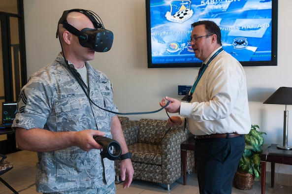 Chief Master Sgt. Edward Slacum (left), 548th Intelligence, Surveillance and Reconnaissance Group superintendent, utilizes a virtual reality headset to explore a C-130 Hercules at Beale Air Force Base, Calif., May 24, 2017. One of the main uses for the VR technology is to provide a hands-on, realistic training environment for Airmen working in intelligence to properly identify aircrafts from various countries. (U.S. Air Force photo by Senior Airman Lauren Parsons/Released)