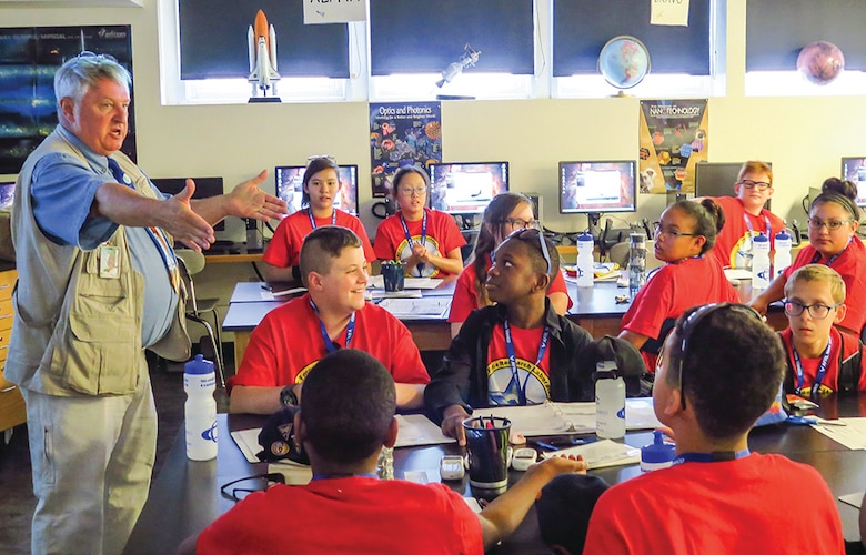 Tuskegee Airmen Inc. Youth Aviation Camp instructor Jim Sauer gives a classroom lecture to camp participants.