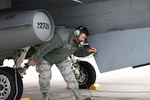 Senior Master Sgt. Robert Shepherd, 132d Wing Public Affairs superintdent and transient alert volunteer, performs a pre-flight check of an F-16c aircraft on May 24, 2017, at the 114th Fighter Wing, Sioux Falls, South Dakota. Shepherd was an F-16 crew chief at the 132d Wing for 16 years before the mission change. (U.S. Air National Guard photo by Tech. Sgt. Nicholas Sirna)