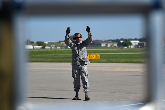 Staff Sgt. John Costello, 132d Wing transient alert, signals to an F-16 on the ramp May 24, 2017 at the 114th Fighter Wing, Sioux Falls, South Dakota. Transient alert volunteers recived refresher training to remain mission qualified. (U.S. Air National Guard photo by Senior Master Sgt. Robert P. Shepherd)