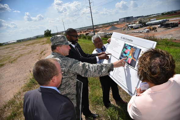 Jeffrey Allen, Air Force Sustainment Center executive director, left, and Maj. Gen. Mark Johnson, Oklahoma City Air Logistics Complex commander, show plans for the future site of the KC-46 sustainment campus to Tim Bridges, assistant deputy chief of staff for logistics, engineering and force protection at the Pentagon, right, during a tour of Tinker Air Force Base June 6. During his visit to Tinker, Bridges gained a better understanding of the AFSC mission following his tour of the Oklahoma City Air Logistics Complex. Bridges also held discussions on the Maintenance Repair and Overhaul Initiative, Functional Risk Reduction Effort, Lean Depot Management System, Requirements Review Depot Determination and Supply Chain Logistics. (Air Force photo by Darren D. Heusel)