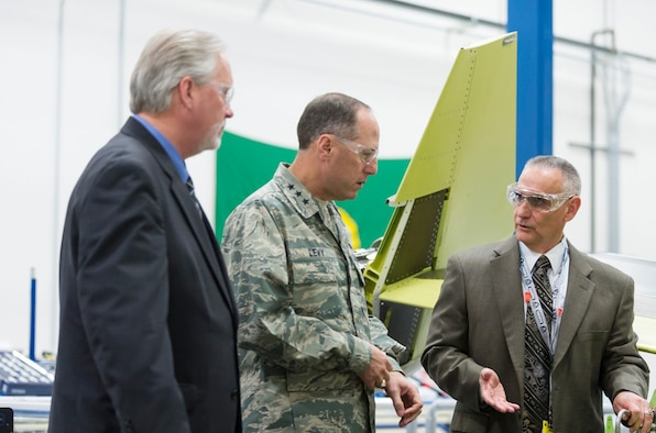 """Lt. Gen. Lee K. Levy II, Air Force Sustainment Center commander, recently toured the Boom Shop at the Boeing Facility in Seattle to review the progress on the KC-46 """"Pegasus,"""" which will be sustained by the AFSC and the Oklahoma City Air Logistics Complex at Tinker Air Force Base, Okla. Escorting the general on the tour are Burt Turner, KC-46 Deputy SPM, left, and Rick Miller with the Boeing Boom Shop. (Courtesy photo)"""
