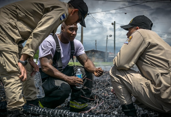 The Siguatepeque and Comayagua Fire Department train with the 612th Air Base Squadron on fire inspecting. The 612th ABS Fire Department host a public fire training at Soto Cano Air Base, June 16, 2017. (U.S. Air Force photo by Senior Airman Julie Kae/released)