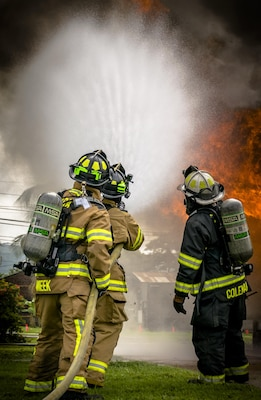 The 612th Air Base Squadron Firefighters control the smoke and fire. The 612th ABS Fire Department host a public fire training at Soto Cano Air Base, June 16, 2017. (U.S. Air Force photo by Senior Airman Julie Kae/released)